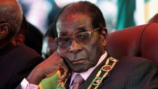 """Robert Mugabe looks on during a rally marking Zimbabwe""""s 32nd independence anniversary celebrations in Harare, Zimbabwe April 18, 2012."""