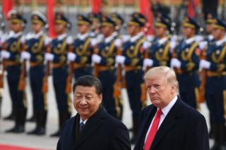 China's President Xi Jinping (L) and US President Donald Trump review Chinese honour guards during a welcome ceremony at the Great Hall of the People in Beijing on 9 November 2017.
