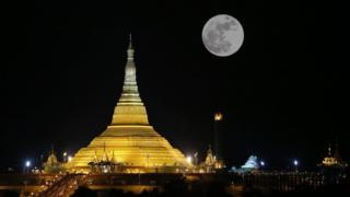 The moon raises over the Uppatasanti Pagoda in Naypyitaw, Burma, 14 November 2016.