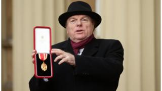 Van Morrison was introduced as Sir Ivan as he received his knighthood from Prince Charles