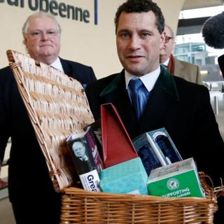 Steven Woolfe carries the Brexit hamper with Digby Jones following
