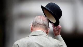 Prince Philip doffs his bowler hat