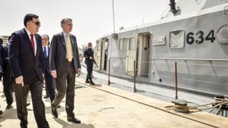 Foreign Secretary Philip Hammond, right, tours a naval base with Libya's prime minister-designate Fayez Sarraj during his visit to Tripoli, Libya