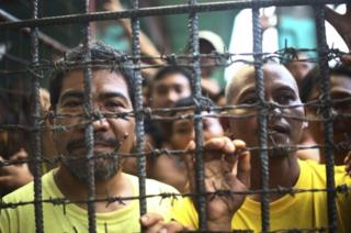 Filipino inmates pictured in their cell at the North Cotabato District Jail in Kidapawan city, Philippines, on 4 January 2017 after a massive jailbreak.