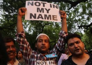 """Indian people hold placard during a """"Not in my Name"""" protest against spate of anti-muslim killings in India,in New Delhi, India, 28 June 2017"""