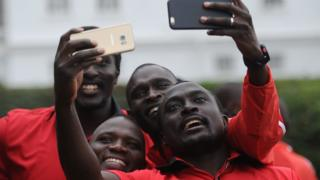Olympic athletes Collins Injera (R), David Rudisha (2ndR), Julius Yego (C) and Humphrey Kayange (L), pose for a selfie picture at the State House in Nairobi - Friday 22 July 2016