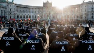 Police officers and protesters in front of the Hofburg Palace, December 18, 17