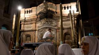 """Christian nuns watch as a team of experts begin renovation of Jesus"""" tomb"""