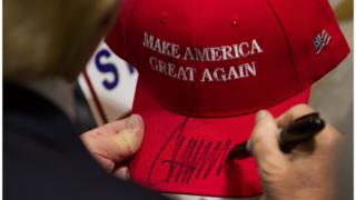 Republican presidential candidate Donald Trump signs a hat after speaking at a rally at the Connecticut Convention Center on April 15, 2016 in Hartford, Connecticut. The 2016 Connecticut Republican Primary is scheduled for April 26, 2016.