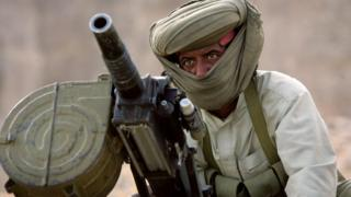 File photo: A Marri tribal guerrilla prepares to fire a grenade launcher at a Pakistani troop outpost January 31, 2006 near Kahan in the Pakistani province of Balochistan