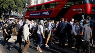 Commuters getting onto a bus