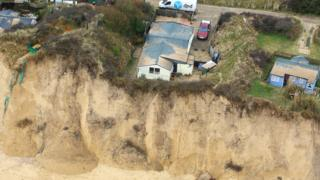 House at risk of falling into sea
