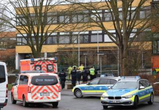 Emergency vehicles stand in front of the Kaethe Kollwitz comprehensive school near Dortmund, Germany, 23 January 2018