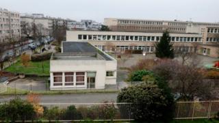 Police outside the school in Aubervilliers, 14 Dec
