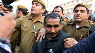 Shiv Kumar Yadav is escorted by police in India following his court appearance in New Delhi, 8 December 2014