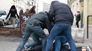 Plain-clothes policemen arrest a man during a protest of students against alleged police brutality in Paris (23 February 2017)