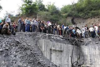 People gather at the site of an explosion in a coal mine in Golestan province, in northern Iran