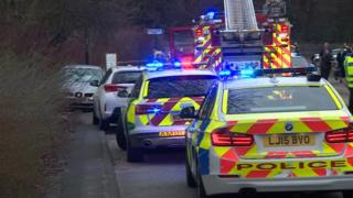 Police and fire engines at the scene of a crash