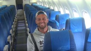 Alex Simon on empty plane