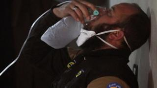 A civil defence worker breathes through an oxygen mask, after a suspected gas attack in the town of Khan Sheikhoun in rebel-held Idlib, Syria, April 4, 2017