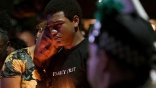 Veronica Hartfield (L), widow of slain Las Vegas Metropolitan Police Department Officer Charleston Hartfield, and their son Ayzayah Hartfield, 15, attend a vigil for Charleston Hartfield at Police Memorial Park in Las Vegas.