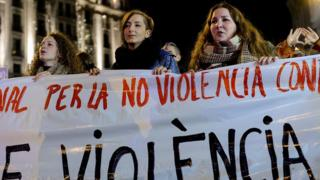 Women hold a banner as they protest during a demonstration against domestic violence in Barcelona on November 25, 2015.