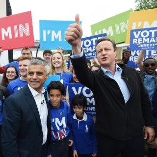 British Prime Minister David Cameron (right) and Mayor of London Sadiq Khan greet supporters during the launch of the battle bus for the Remain In campaign at Froebel College of the University of Roehampton in London