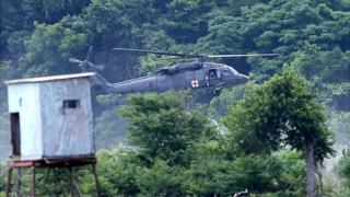 A military Helicopter joins in the search efforts Friday, June 3, 2016, for 6 missing soldiers from Fort Hood, Texas. (Rusty Schramm/The Temple Daily Telegram via AP) MANDATORY CREDIT