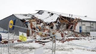 A Lidl supermarket was bulldozed with a digger during the incident