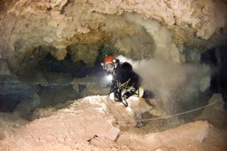 Xisco Gracia kicking up silt in an underwater cavern