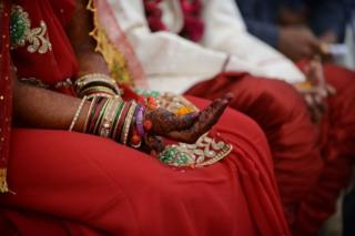 Representational image of a bride and groom