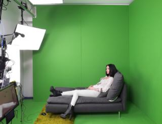 a indication poses in a green-screen studio