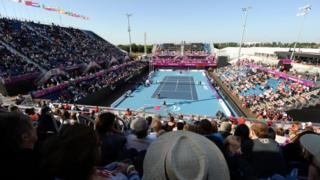 US player Nicholas Taylor and his partner David Wagner take on Britain's Andy Lapthorne and Peter Norfolk in the wheelchair tennis mixed quad doubles final at the London 2012 Paralympic Games at the Olympic Park