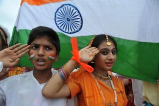 "In this photograph taken on August 30, 2012, Indian school children salute as they stand to attention and sing the national anthem ""Jana Gana Mana"" in Hyderabad."