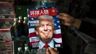 """A copy of the local Chinese magazine Global People with a cover story that translates to """"Why did Trump win"""" is seen with a front cover portrait of US president-elect Donald Trump (14 Nov)"""