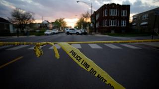 Chicago Police crime tape is displayed at the scene.