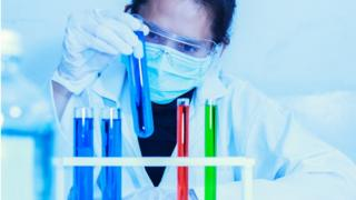 Scientists in a drugs laboratory