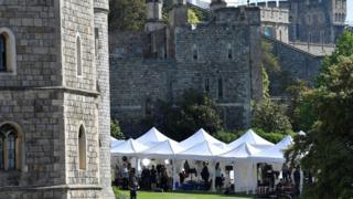 Television crews report from the scene at Windsor Castle before the upcoming wedding