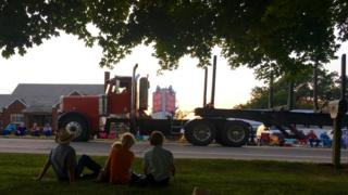Amish watching truck parade