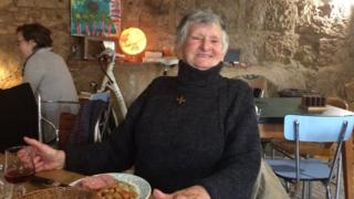 Pensioner Genevieve enjoys her birthday lunch in the Veloc café in Perigueux, south-west France