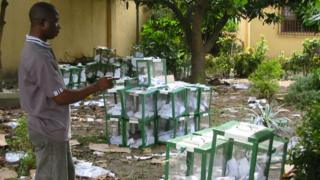 An official of the Independent National Electoral Commission counts ballot boxes collected at its headquarters after the Nigerian legislative elections in the Niger Delta, 3 May 2003