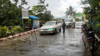 Police inspect cars at an entry point after deadly attacks near Maungdaw town on the Bangladesh-Myanmar border