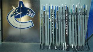 """A Twitter picture featuring hockey sticks left outside. Caption: """"We've left a few of these outside the dressing room tonight. #PutYourSticksOut"""""""