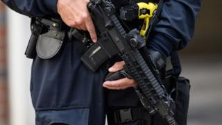 Close-up of armed police's automatic weapon, near Borough Market