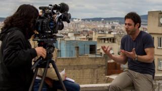 Rami Jarrah speaking to a film crew (2015)
