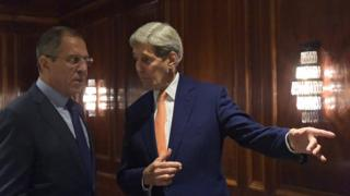 A handout picture released by the Russian Foreign Ministry Press Service shows Russian Foreign Minister Sergei Lavrov (L) and US Secretary of State John Kerry (R) during their meeting at the Imperial Hotel in Vienna, Austria