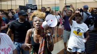 Protesters march through the West County Center in St Louis' Des Peres suburb. Photo: 16 September 2017