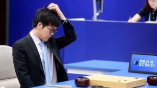 China's 19-year-old Go player Ke Jie reacts during the first match against Google's artificial intelligence programme AlphaG