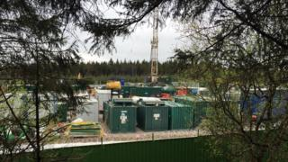 The drill is behind a fence in Woodburn forest