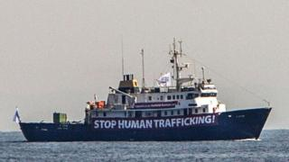 "A banner that reads, ""Stop Human Trafficking"" is attached to the side of the C-Star as it sailed in the Mediterranean Sea"